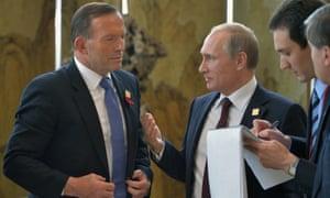Vladimir Putin and Tony Abbott talk at the Beijing Apec summit.