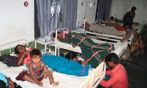 Victims lie on hospital beds. More than 80 women underwent surgery at the camp.