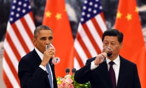 Barack Obama and Chinese President Xi Jinping have a drink after a toast at a lunch banquet in the Great Hall of the People in Beijing.