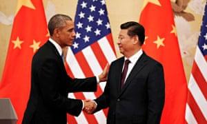 Barack Obama and Xi Jinping shake hands