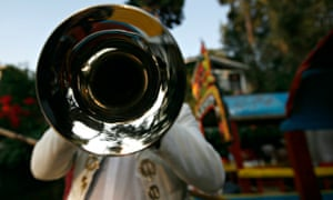 A mariachi plays his trumpet on the outskirts of Mexico City