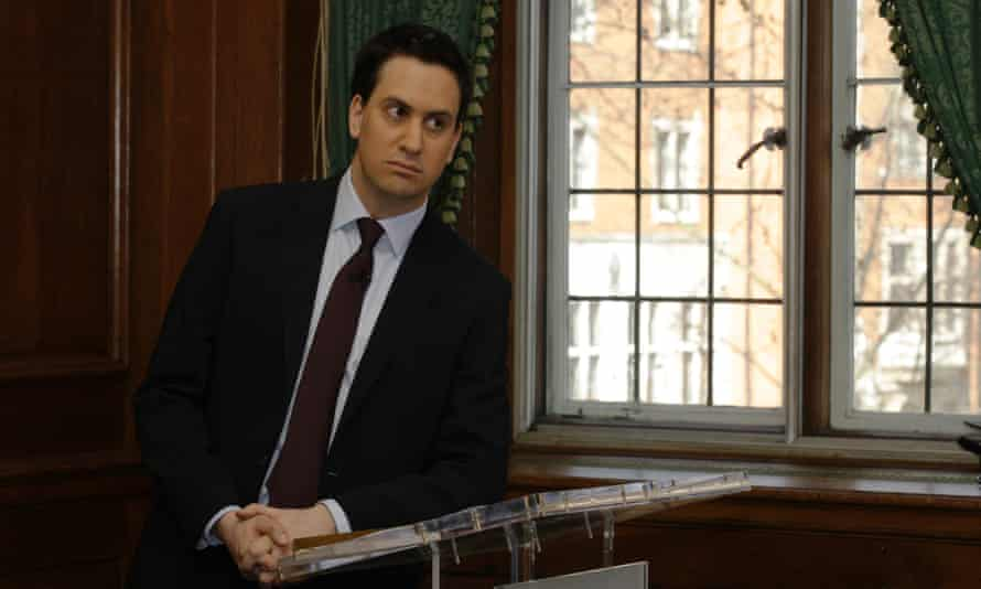 In this file photo, Britain's Labour party leader Ed Miliband listens to the shadow chancellor speaking to the media calling for the budget in London.