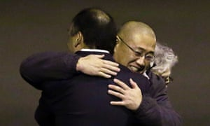Kenneth Bae, centre, arrives on US soil on 8 November. He had been held in North Korea since 2012.