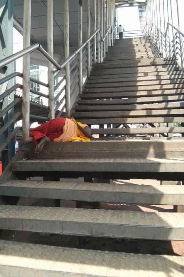 A homeless woman sleeping on the steps of Bandra West skywalk.