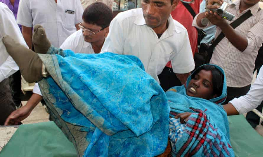 A woman is taken to hospital
