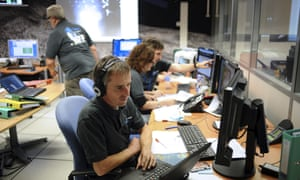 Scientists work in the scientific mission observation centre of the French space agency Centre National d'Etudes Spatiales in Toulouse, southern France