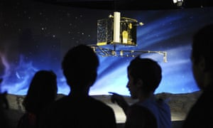 Children look at a model of the European Space Agency's robot craft Philae as they visit the Cite de l'espace in Toulouse