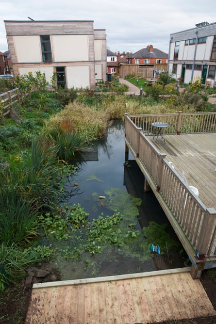 Rain drains into a communal pond at the centre of the development.
