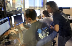 Scientists look on a computer screen at the first picture transmitted by the European Space Agency's robot craft Philae, in the scientific mission observation centre of the French space agency
