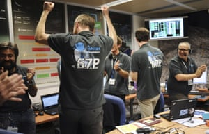 Scientists celebrate in the scientific mission observation centre of the French space agency as they receive information that the robot craft Philae has landed on the Churyumov-Gerasimenko comet