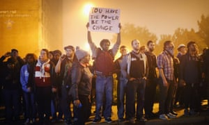Demonstrators march through the street last month in St Louis, Missouri.