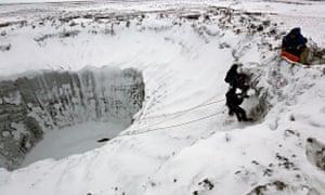 Russian scientists examine crater Yamal peninsula. Photograph: Vladimir Pushkaryov/Itar-TassPhoto/Corbis