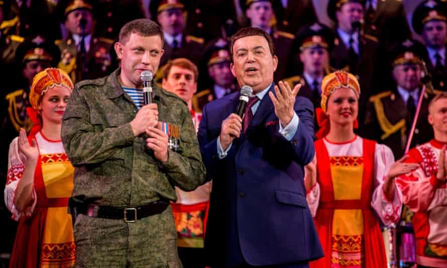 Russian singer Iosif Kobzon and rebel prime minister Aleksandr Zakharchenko sing a Soviet song during a concert in Donetsk Ukraine