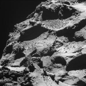 Rosetta mission: rubble-filled depressions appear in sharp relief in this image