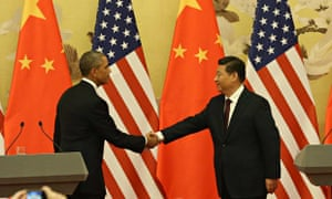 Chinese President Xi Jinping shakes hands with US President Barack Obama