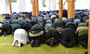 Worshippers at Aarhus's Grimhojvej mosque. Last year 22 young men from the mosque left to become jihadists in Syria.