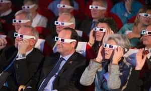 French National Centre for Space Studies president Jean-Yves Le Gall, left, French president Francois Hollande, centre, and former French minister and astronaut Claudie Haignere, right, wear 3D glasses during a broadcast of the Rosetta mission at the Cite des Sciences, Paris.