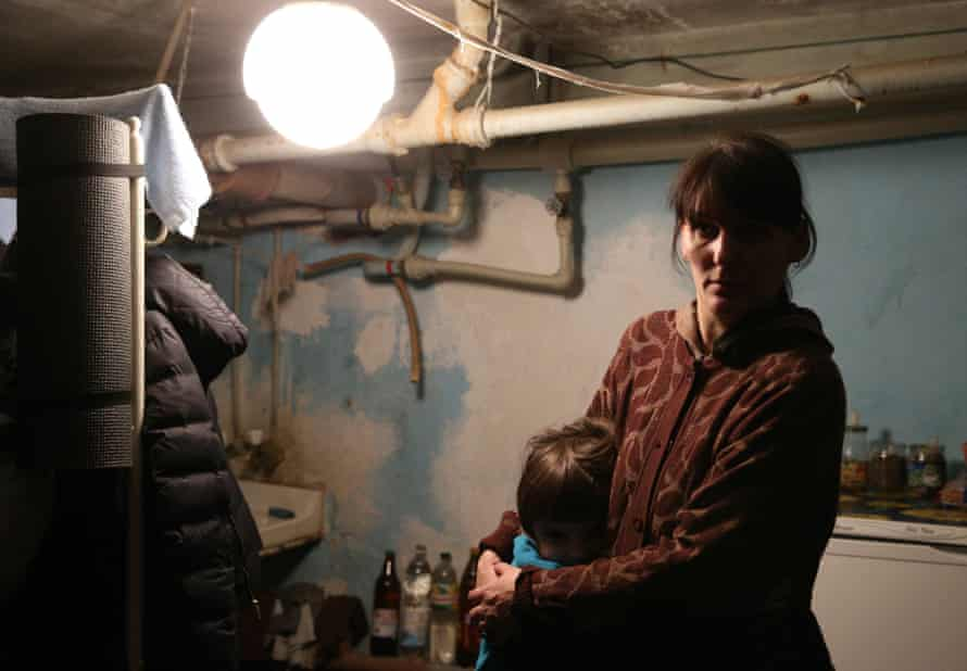 A woman takes shelter with her child in the basement of the 21st hospital of Donetsk's Oktyabrsk district in Ukraine