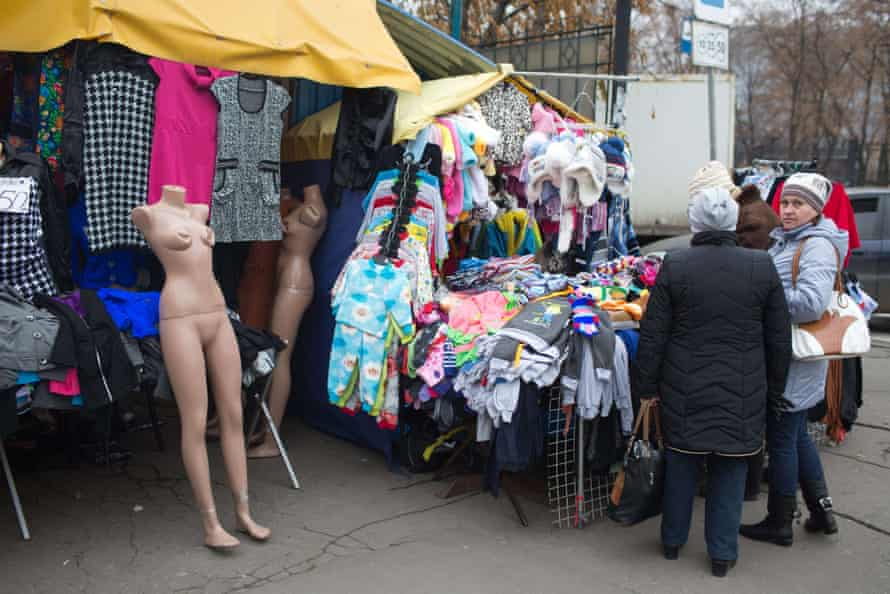 Ukrainian women buy clothes at the city centre market in Donetsk.