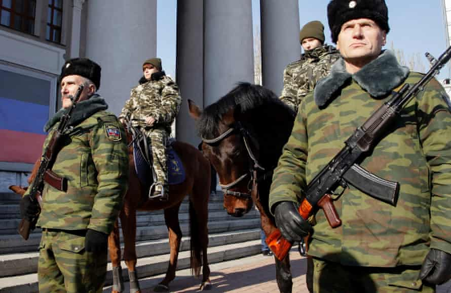 Armed rebels stand guards during the inauguration of Alexander Zakharchenko as new head of the self-proclaimed Donetsk People's Republic. ukraine