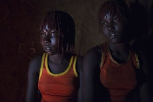 Pokot girls wait together the evening before a circumcision ceremony