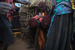 Pokot girls are encouraged to leave their hut and make their way to a place where they will take off their clothes and wash during their circumcision ceremony