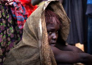 A Pokot girl cries after being circumcised