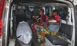 A woman is mourned as her body lies in the back of a van after botched sterilisation surgery in Chhattisgarh, India.
