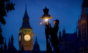 Lamp attendant Martin Caulfield lighting one of London's historic gas street lamps in the traditional fashion to mark the 200th anniversary of gas lighting in the capital in 2007.