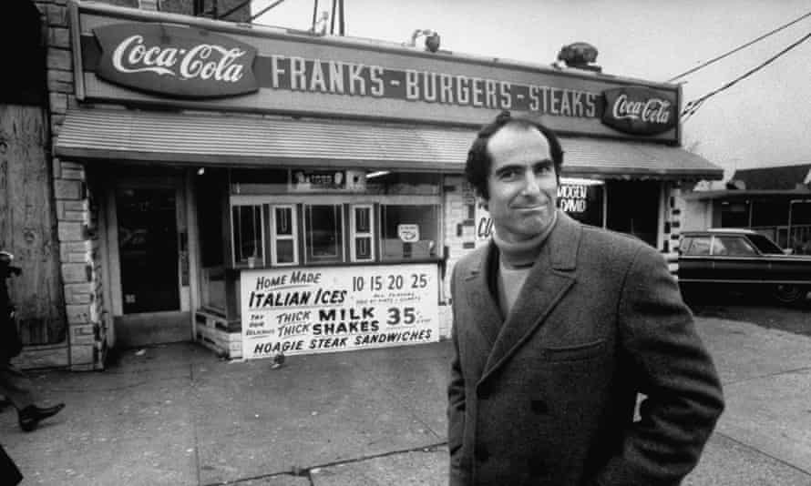 The author Philip Roth revisits areas where he grew up in Newark, standing at hamburger stand.