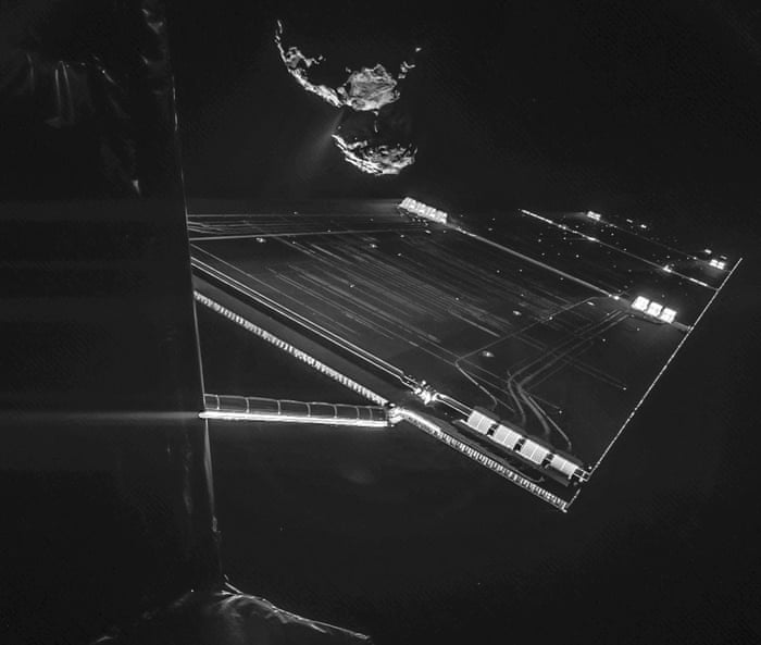 A picture taken with the CIVA camera on Rosettas Philae lander showing comet 67P/ChuryumovGerasimenko from a distance of about 16 km from the surface of the comet. The 'selfie' image was taken on October 7, 2014 and captures the side of the Rosetta spacecraft and one of Rosettas 14 m-long solar wings, with the comet in the background. Two images with different exposure times were combined to bring out the faint details in this very high contrast situation. The comet's active neck region is clearly visible, with streams of dust and gas extending away from the surface.