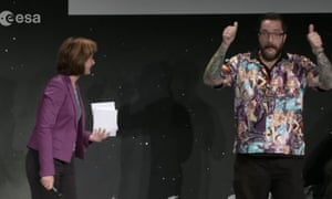 Screengrab of Dr Matt Taylor introduced on stage Monika Jones during a video livestream of European Space Agency's Rosetta mission.