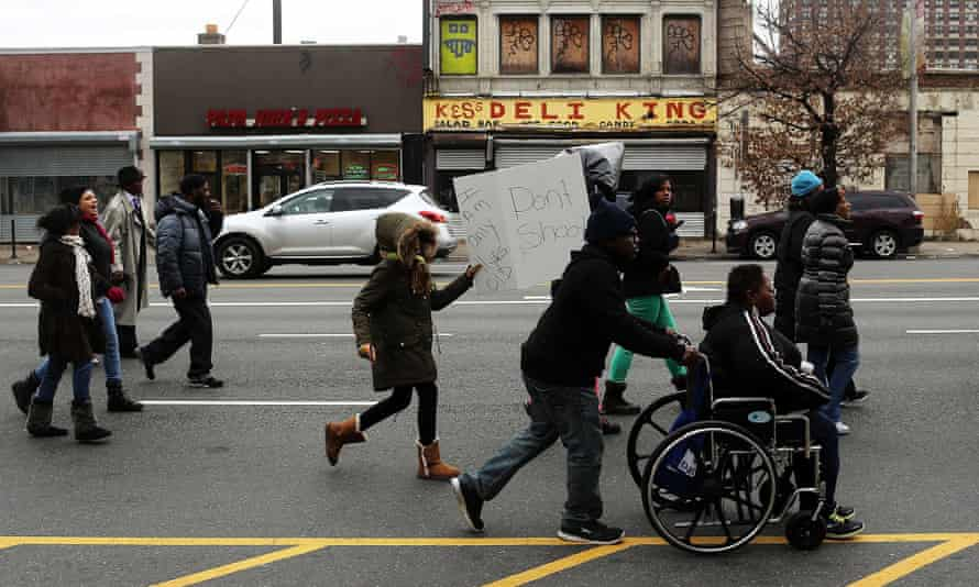 Dozens of residents, activists and community leaders participate in a march and rally against violence on 30 December 2013 in Newark. Newark had witnessed a surge in murders, car jacking and other criminal acts in the preceding months.