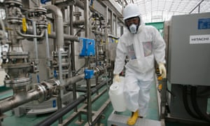 A Tepco worker in protective gear works at the back of the new Alps water-treatment system, which should be able to process 2,000 tonnes of contaminated water per day.