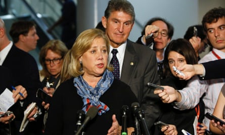 Mary Landrieu and Joe Manchin discuss the vote with reporters in Washington.