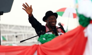Goodluck Jonathan waves to supporters after declaring his intention to run in the February 2015 presidential election.