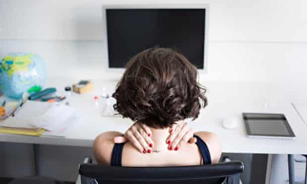 A stressed woman at work
