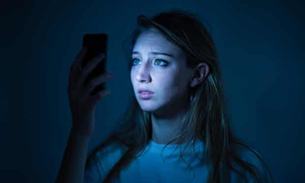 Young woman smartphone looking worried about cyber bullying