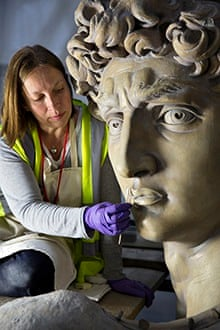 Johanna Puisto, sculpture conservator at the Victoria and Albert Museum, works on the David statue
