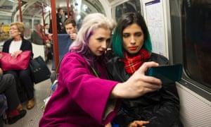 Masha Alyokhina (left) and Nadya Tolokonnikova from Pussy Riot do some London sightseeing.