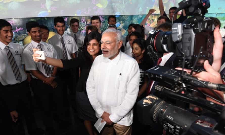 Narendra Modi stops for a selfie during his visit to the Queensland University of Technology in Brisbane on Friday