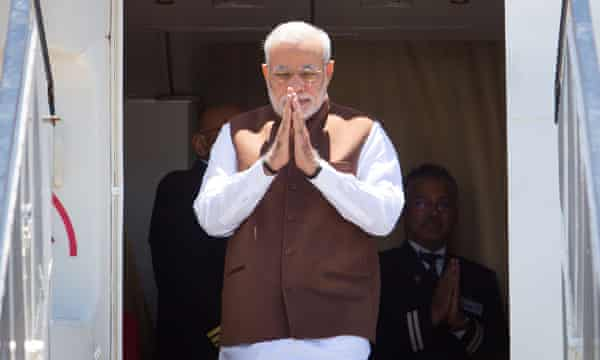 Modi gesturing arrives in Brisbane for the G20 summit.