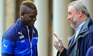 Italy forward Mario Balotelli talks with priest Don Massimiliano during his team's training session in Florence.