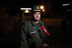 French lieutenant Robert Picaud speaks to the press as police and firefighters are hunting for a tiger on the loose in Montevrain, near Paris after a local resident spotted the fearsome animal in a car park and sounded the alert, authorities said. Around 60 firefighters and police officers have been deployed in the search, as well as a dog trained in tracking bears and large game.