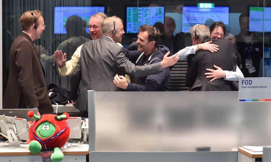 Rosetta: staff cheer in the main Esa control room in Darmstadt, Germany, after the signal from Philae arrives.