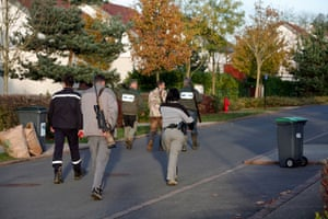 Members of the police animal brigade walk through the streets of Montevrain, east of Paris. French authorities say a young tiger is on the loose near Disneyland Paris, one of Europe's top tourist destinations, and have urged residents in three towns to stay indoors.
