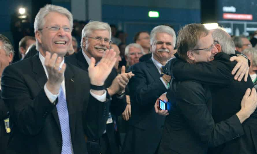 From left to right, ESA director Thomas Reiter, Johann-Dietrich Woerner, chair of the supervisory board of the German Space and Aeronautics Agency (DLR), and ESA general director Jean-Jacques Dordain celebrate.