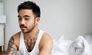 Unhappy man sitting on the bed