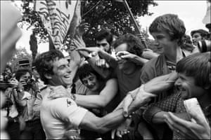 22 July 1978 Paris, France Bernard Hinault celebrates with spectators after winning the 65th Tour De France, the first of his five Tour de France victories
