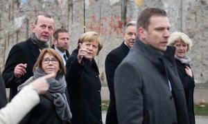 Germany's chancellor, Angela Merkel, at the Berlin Wall.